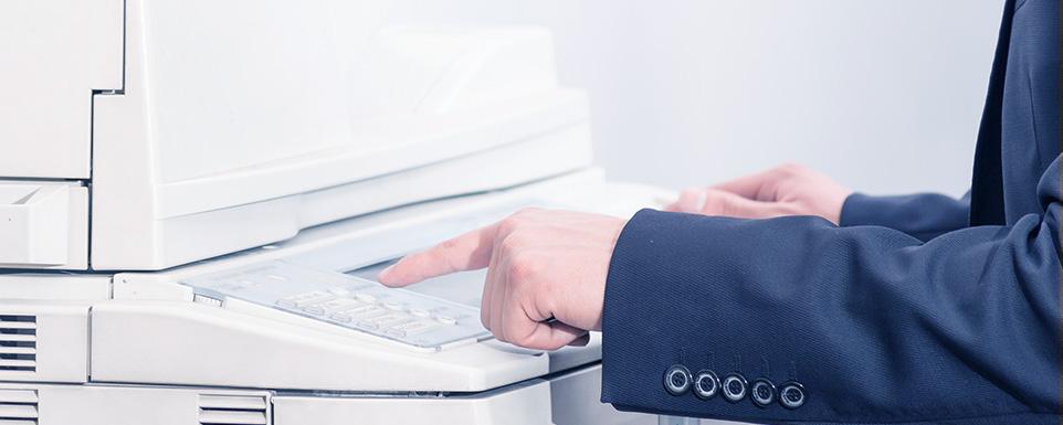 Man-Using-Printer